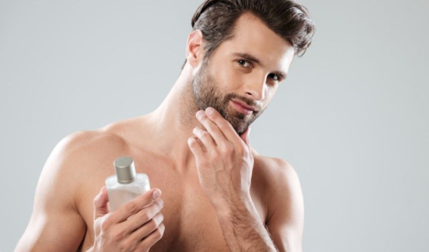 Man touching his spotted beard and holding hair conditioner